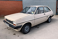 BNPS.co.uk (01202 558833)<br /> Pic: HampsonAuctions/BNPS<br /> <br /> Pictured: 1983 Ford Fiesta Popular Plus.<br /> <br /> Since the 1990s, Geoff Barlow, 46, has collected dozens of classic cars from an Escort Mexico replica to several types of Transit, Cortina, and Sierra.<br /> <br /> However, he still regrets selling the first car which inspired his passion, a 1980 Escort Mark 2 he bought from his sister in 1992.  <br /> <br /> Geoff's fascination with Fords gathered pace in the last decade and he 'lost control,' buying as many Fords as he came across and saving them from disrepair.