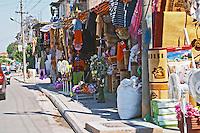 Street scene in Koplik near Shkodra with street market with market stalls selling all sorts of household goods. Albania, Balkan, Europe.