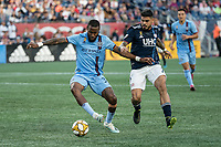 FOXBOROUGH, MA - SEPTEMBER 29: Sebastien Ibeagha #33 of New York City FC controls the ball during a game between New York City FC and New England Revolution at Gillettes Stadium on September 29, 2019 in Foxborough, Massachusetts.