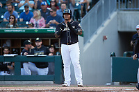 Yermin Mercedes (24) of the Charlotte Knights waits at home plate to greet teammate Luis Gonzalez (not pictured) during the game against the Gwinnett Stripers at Truist Field on July 15, 2021 in Charlotte, North Carolina. (Brian Westerholt/Four Seam Images)