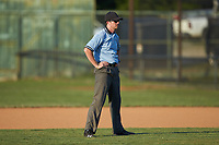 Umpire Jared Torrence handles the calls on the bases during the game between the Dry Pond Blue Sox and the Mooresville Spinners at Moor Park on July 2, 2020 in Mooresville, NC.  The Spinners defeated the Blue Sox 9-4. (Brian Westerholt/Four Seam Images)