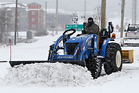 Patrick McCullough, owner of Pro-Mow, clears the parking lot Monday, February 15, 2021, at Pinnacle Foods in Fayetteville. The National Weather Service is forecasting several inches of snow throughout the state through Wednesday and Thursday. Check out nwaonline.com/210216Daily/ and nwadg.com/photos for a photo gallery.<br /> (NWA Democrat-Gazette/David Gottschalk)