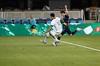 SAN JOSE, CA - SEPTEMBER 19: Carlos Fierro #21 of the San Jose Earthquakes is defended by Julio Cascante #18 of the Portland Timbers during a game between Portland Timbers and San Jose Earthquakes at Earthquakes Stadium on September 19, 2020 in San Jose, California.