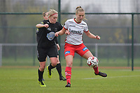 Zulte Waregem's forward Corina Luijks (R) and Woluwe's Jana Simons (L)  pictured during a female soccer game between SV Zulte - Waregem and White Star Woluwe on the 9th matchday of the 2020 - 2021 season of Belgian Scooore Women s SuperLeague , saturday 12 th of December 2020  in Waregem , Belgium . PHOTO SPORTPIX.BE | SPP | DIRK VUYLSTEKE