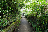 Pictured: A footpath leading to river Ogmore in Sarn near Bridgend, Wales, UK. Monday 02 August 2021 <br /> Re: South Wales Police can confirm that  three people have been arrested following reports of concerns for a missing 5 year old boy, named as Logan Williamson or Logan Mwangi, in Sarn, Bridgend, and the subsequent finding of the body in the Ogmore River near Pandy Park, Bridgend, Wales, UK.<br /> A 39 year male, 30 year female and 13 year old male, all from the Bridgend area, have been arrested on suspicion of murder and are currently in police custody.  We are not looking for anyone else in relation to this incident.