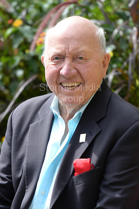 FLUSHING NY- SEPTEMBER 09: Bud Collins and his wife Anita Ruthling Klaussen pose for a portrait at Arthur Ashe Stadium  at USTA Billie Jean King National Tennis Center on September 09, 2013 in in Flushing Queens<br /> <br /> <br /> People:  Bud Collins