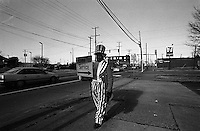 A Young man dressed as Uncle Sam works as a human billboard for a tax service business to make a wage. Newport News, Virginia, USA,  January 2004 © Stephen Blake Farrington