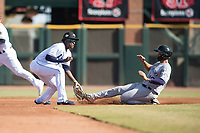 Peoria Javelinas shortstop Lucius Fox (5), of the Tampa Bay Rays organization, prepares to apply the tag to Josh Fuentes (19) as he slides into second base on a stolen base attempt during the Arizona Fall League Championship Game against the Salt River Rafters at Scottsdale Stadium on November 17, 2018 in Scottsdale, Arizona. Peoria defeated Salt River 3-2 in 10 innings. (Zachary Lucy/Four Seam Images)