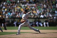 OAKLAND, CA - JUNE 21:  Koji Uehara #19 of the Boston Red Sox pitches against the Oakland Athletics during the game at O.co Coliseum on Saturday, June 21, 2014 in Oakland, California. Photo by Brad Mangin