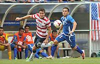 Rodolfo Zelaya (11) of El Salvador goes against Matt Besler (25) of the USMNT. The USMNT defeated El Salvador 5-1 at the quaterfinal game of the Concacaf Gold Cup, M&T Stadium, Sunday July 21 , 2013.