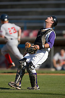 Catcher Logan Johnson #18 of the Winston-Salem Dash chases after an infield pop fly at Wake Forest Baseball Park May 10, 2009 in Winston-Salem, North Carolina. (Photo by Brian Westerholt / Four Seam Images)