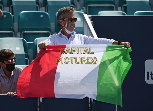 MIAMI GARDENS, FL - APRIL 04: a man is seen holding the Italian Flag as Hubert Hurkacz Vs Jannik Sinner, Hubert Hurkacz defeating Jannik Sinner 7-6 (7-4) 6-4 during the Men's finals at the 2021Miami Open at Hard Rock Stadium on April 4, 2021 in Miami Gardens, Florida. <br /> CAP/MPI04<br /> ©MPI04/Capital Pictures