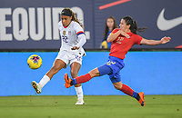 JACKSONVILLE, FL - NOVEMBER 10: Jessica McDonald #22 of the United States passes ball past Lixy Rodriguez #12 of Costa Rica during a game between Costa Rica and USWNT at TIAA Bank Field on November 10, 2019 in Jacksonville, Florida.