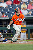 Miami Hurricanes catcher Zack Collins (0) watches his first inning home run fly over the right field fence against the UC Santa Barbara Gauchos in Game 5 of the NCAA College World Series on June 20, 2016 at TD Ameritrade Park in Omaha, Nebraska. UC Santa Barbara defeated Miami  5-3. (Andrew Woolley/Four Seam Images)
