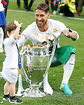 Real Madrid's Sergio Ramos celebrates with his son the victory in the UEFA Champions League 2015/2016 Final match.May 28,2016. (ALTERPHOTOS/Acero)