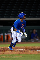 AZL Cubs 1 Albert Hinirio (22) starts running towards first base during an Arizona League game against the AZL Angels on June 24, 2019 at Sloan Park in Mesa, Arizona. AZL Cubs 1 defeated the AZL Angels 12-0. (Zachary Lucy / Four Seam Images)
