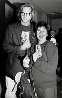 1990 FILE PHOTO - ARCHIVES -<br /> <br /> Baby talk: Actor Liam Neeson (Darkman) helps director Gail Harvey show off her baby pictures.<br /> <br /> 1990<br /> <br /> PHOTO :  Erin Comb - Toronto Star Archives - AQP