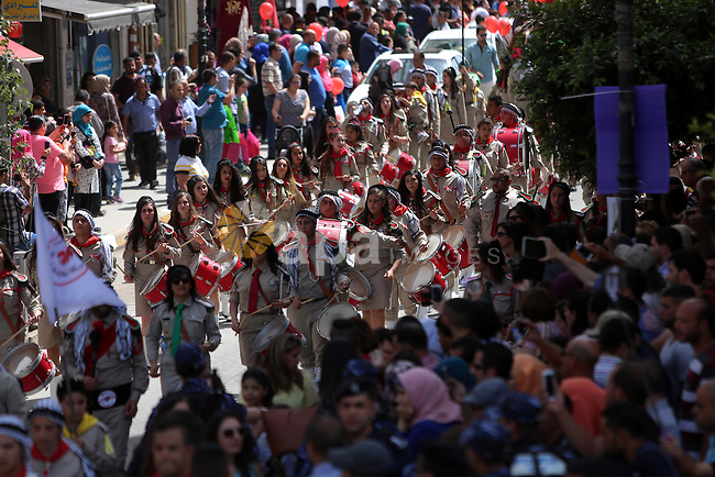 Palestinian christians march in the traditional Sabt al-Nour parade, in the West Bank city of Ramallah, on April 30, 2016. The Holy Fire is described by Orthodox Christians as a miracle that occurs every year at the Church of the Holy Sepulchre in Jerusalem on Great Saturday, or Holy Saturday, the day preceding Orthodox Easter. Photo by Shadi Hatem