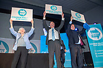 Brexit Party EU elections campaign launch at  The Neon in Newport, South Wales. Brexit Party Leader Nigel Farage  holding up  placards alongside Ann Widdecombe and James Wells of the Brexit Party at the end of the event.
