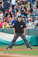 Base umpire Chris Gonzalez during the game between the Nashville Sounds and the Salt Lake Bees at Smith's Ballpark on June 23, 2014 in Salt Lake City, Utah.  (Stephen Smith/Four Seam Images)