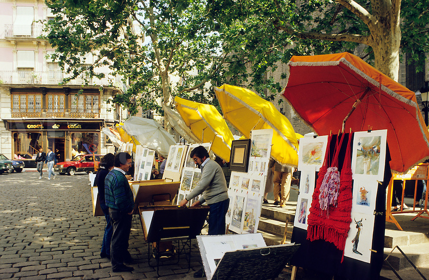 Barcelona, Spain.  Art market in the Plaza St. Josep Oriol, Barrio Gotico/old town..