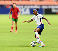 HOUSTON, TX - JUNE 10: Crystal Dunn #19 of the United States turns the ball around while advancing up the field during a game between Portugal and USWNT at BBVA Stadium on June 10, 2021 in Houston, Texas.