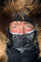 Sonny Lindner, like most other mushers, arrives at the Nikolai checkpoint on Tueday bundled up and frosted