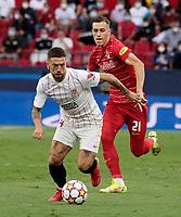 """14th September 2021; Sevilla, Spain: UEFA Champions League football,  Sevilla FC versus RB Salzburg;  Alejandro Dario """"Papu"""" Gomez of Sevilla breaks away from Luka Sucic of Salzburg"""