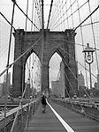 Black and white of Brooklyn Bridge walkway.