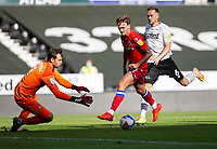 12th September 2020; Pride Park, Derby, East Midlands; English Championship Football, Derby County versus Reading; John Swift of Reading chased by Mike Te Wierik of Derby County attempts a shot at goal but Derby County Goalkeeper David Marshall gets his hands to the ball