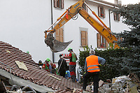 A crane among rubble of collapsed buildings in the village of Amatrice, central Italy, hit by a magnitude 6 earthquake at 3,36 am, 24 August 2016.<br /> Una gru al lavoro tra le macerie degli edifici crollati dopo il terremoto che alle 3,36 del mattino ha colpito Amatrice, 24 agosto 2016.<br /> UPDATE IMAGES PRESS/Isabella Bonotto