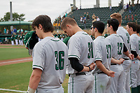 Dartmouth Big Green players, including Trevor Johnson (36) and Tyler Fagler (31), stand for the national anthem before a game against the USF Bulls on March 17, 2019 at USF Baseball Stadium in Tampa, Florida.  USF defeated Dartmouth 4-1.  (Mike Janes/Four Seam Images)