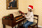 Pictured: Collections manager Sophie Reynolds lays down a Christmas garland on the piano in the drawing room as part of the Christmas experience as the Jane Austen's House Museum prepares to reopen to the public for the second time this year. <br /> <br /> Dame Emma Thompson has come to the aid of Jane Austen's former home by providing the voice to a new online Christmas experience.<br /> <br /> From today fans of the novelist can hear the actor - who won an Oscar for her screenplay for the 1995 film adaptation Sense and Sensibility - read from some of her books and letters.<br /> <br /> The 61 year old has recorded eight tracks for the Jane Austen House museum, which showcase her 'dry wit and enjoyment' of yuletide traditions.<br /> <br /> This week staff at the House in Chawton, Hants, have been putting up Christmas decorations in the hope that they will be able to reopen on December 3 if restrictions are eased, so visitors can enjoy the experience first hand.  SEE OUR COPY FOR FULL DETAILS.<br /> <br /> © Jordan Pettitt/Solent News & Photo Agency<br /> UK +44 (0) 2380 458800