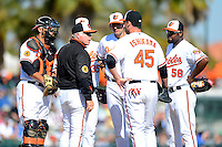 Baltimore Orioles manager Buck Showalter #26 makes a pitching change as Luis Exposito #59, Danny Valencia #35 (hidden), Ryan Flaherty #3, Travis Ishikawa #45, and Yamaico Navarro #58 look on during a Spring Training game against the Toronto Blue Jays at Ed Smith Stadium on March 7, 2013 in Sarasota, Florida.  Balitmore defeated Toronto 11-10.  (Mike Janes/Four Seam Images)