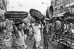 Freelance porters wait for custmer at Koley market in Kolkata, India