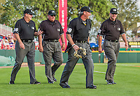 5 March 2015: The MLB Umpires take the field to start a Spring Training game between the Washington Nationals and the New York Mets at Space Coast Stadium in Viera, Florida. Pictured are (left to right): Gary Cederstrom, Hunter Wendelstedt, Paul Nauert, and Ed Hickox.  The Nationals rallied to defeat the Mets 5-4 in their Grapefruit League home opening game. Mandatory Credit: Ed Wolfstein Photo *** RAW (NEF) Image File Available ***