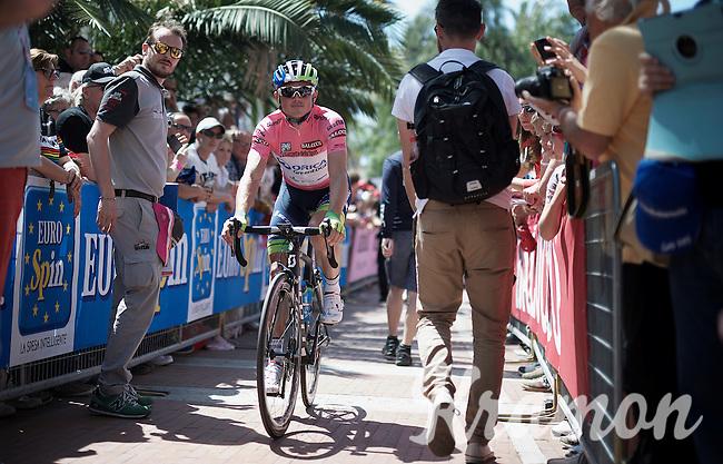 'maglia rosa' Simon Gerrans (AUS/Orica-GreenEDGE) coming back from the start podium in Albenga<br /> <br /> 2015 Giro<br /> stage 2: Albenga - Genova (177km)