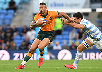 2nd October 2021, Cbus Super Stadium, Gold Coast, Queensland, Australia;  Quade Cooper holds off a tackle.<br /> Australian Wallabies versus Argentina Pumas. Rugby Championship test match. Rugby Union. Gold Coast, Australia.