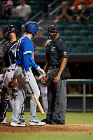 Oklahoma City Dodgers Drew Jackson (22) argues a call with home plate umpire J.J. January during a Pacific Coast League game against the New Orleans Baby Cakes on May 6, 2019 at Shrine on Airline in New Orleans, Louisiana.  New Orleans defeated Oklahoma City 4-0.  (Mike Janes/Four Seam Images)
