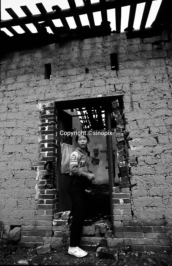 A lady enters a house that  was destroyed by the Birth Control Unit. The family's parents ran away rather than besterlised by the Birth Control Unit. As punishment their house in north guangdong was destroyed.
