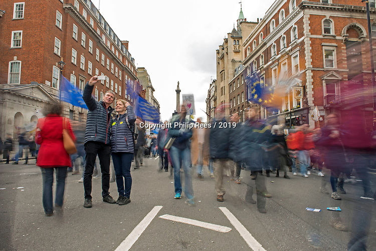 """A couple pose for a selfie during the """"Put it to the People"""" rally which made it's way through central London today. Demonstrators from across the country gathered to call for a second referendum on Brexit and to march through the UK capital finishing with speeches in Parliament Square opposite the Houses of Parliament in Westminster."""