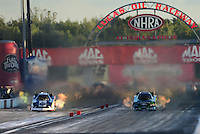 Sept 8, 2012; Clermont, IN, USA: NHRA funny car driver Alexis DeJoria (right) races alongside Tim Wilkerson during qualifying for the US Nationals at Lucas Oil Raceway. Mandatory Credit: Mark J. Rebilas-