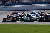#20: Christopher Bell, Joe Gibbs Racing, Toyota Supra Rheem-Johns Mansville and #22: Austin Cindric, Team Penske, Ford Mustang MoneyLion