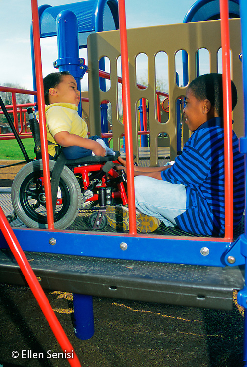 MR / Schenectady, NY.Zoller Public School - Inclusion Class - Grade 1.Friends on playground. (Boy left: 7, Bangladeshi, Puerto-Rican-American, spina bifida, sacral agenesis; Boy right: 8, Puerto-Rican-American, scoliosis).MR: Rah1, Esc1.PN#: 28604                           FC#: 20338-00611.scan from slide.©Ellen B. Senisi