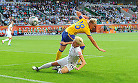 Megan Rapinoe (r) of team USA and Nilla Fischer of team Sweden during the FIFA Women's World Cup at the FIFA Stadium in Wolfsburg, Germany on July 6thd, 2011.
