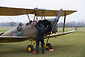 """13/03/15<br /> <br /> Getting ready to start the engine.<br /> <br /> ***FULL STORY HERE:   http://www.fstoppress.com/articles/tiger-moth-restorations/    ****<br /> <br /> You may remember spending hours toiling over Airfix models, painstakingly following intricate instructions and trying not to glue your fingers together before painting your own miniature version of one of the RAF's or Luftwaffe's finest aircraft. Then spare a thought for one man who has just helped to restore and put together one World War Two Tiger Moth and is about to start piecing together another FOUR aircraft that were discovered in bits in a barn.<br /> <br /> Sixty-year-old Colin Temple-Smith – who wears a moustache that any Wing Commander would be proud of – has spent a lifetime restoring vintage cars and motorcycles and recently quit his job as a window fitter to help re-build the five bi-planes that will become part of a growing fleet of Tiger Moths at Derbyshire based Blue Eye Aviation.<br /> <br /> Today saw the first of the fully-restored five aircraft take to the skies.<br /> <br /> """"It's just like working on old bikes and cars, although they're a lot more fragile"""" explained Colin, whose wife runs the Aviators Café at Darley Moor Airfield near Ashbourne.<br /> <br /> """"When I was a teenager I used to be a member of a modelling club, making flying models from wood and canvas. They're very similar to build – it's really just the size that's changed with these.<br /> <br /> All Rights Reserved: F Stop Press Ltd. +44(0)1335 418629   www.fstoppress.com."""