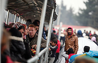 Pictured: Refugees at the border Monday 29 February 2016<br /> Re: A crowd of migrants has burst through a barbed-wire fence on the FYRO Macedonia-Greece border using a steel pole as a battering ram.<br /> TV footage showed migrants pushing against the fence at Idomeni, ripping away barbed wire, as FYRO Macedonian police let off tear gas to force them away.<br /> A section of fence was smashed open with the battering ram. It is not clear how many migrants got through.<br /> Many of those trying to reach northern Europe are Syrian and Iraqi refugees.<br /> About 6,500 people are stuck on the Greek side of the border, as FYRO Macedonia is letting very few in. Many have been camping in squalid conditions for a week or more, with little food or medical help.