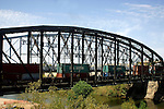 FREIGHT TRAIN CROSSES BRIDGE