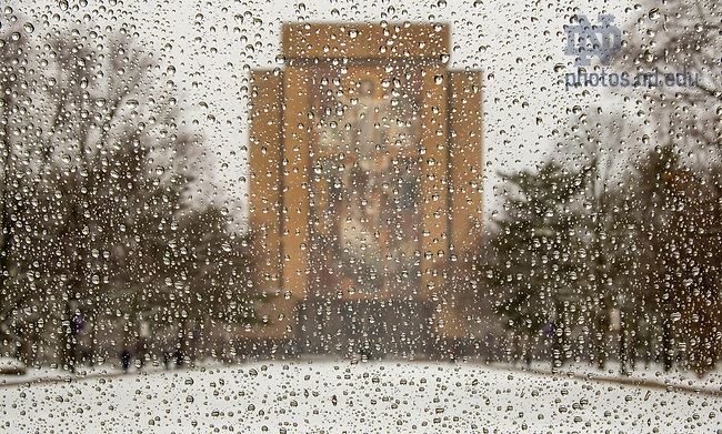 February 26, 2020; View of the Hesburgh Library through a window with water drops during a snowfall. (Photo by Barbara Johnston/University of Notre Dame)