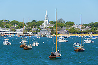 Sailboats and other pleasure craft moored in Nantucket harbor in Nantucket, Massachusetts.